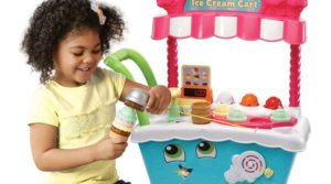 Girl playing with LeapFrog Ice Cream Cart Toys