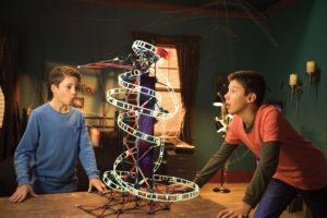 Two boys playing with KNEX Roller Coaster Toy