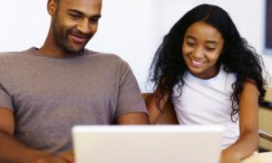 Father and Daughter looking at laptop together